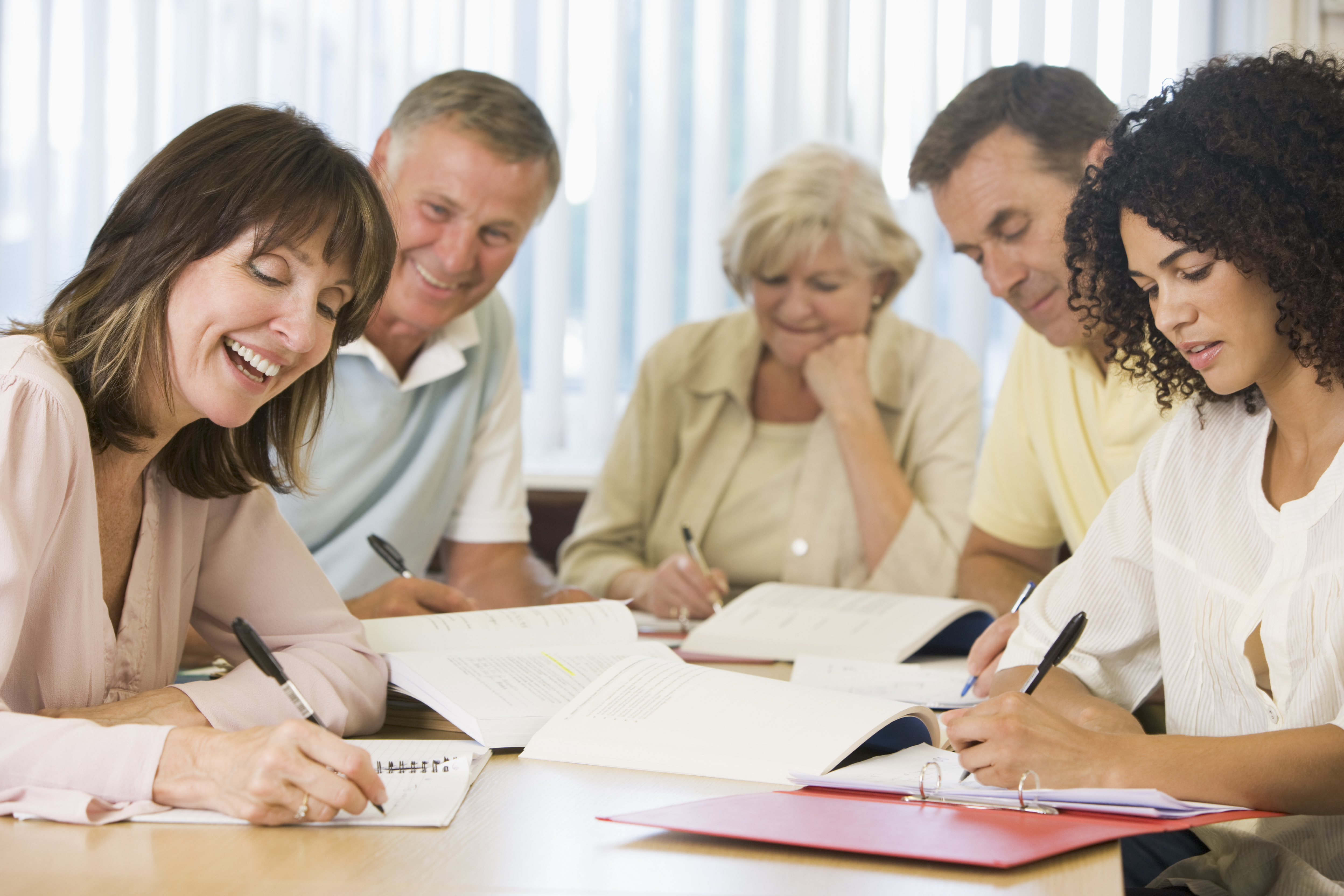 shutterstock_15258847_adults writing together